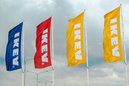 self assembly: SZEGED HUNGARY  MAY 27 2015: Ikea banners waving on wind. Ikea is famous multinational company that designs and sells readytoassemble furniture and operates in 40 countries. Editorial