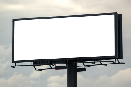 Blank Outdoor Advertising Billboard Hoarding Against Cloudy Sky, White Copy Space for Mock Up Design or Marketing Message Archivio Fotografico