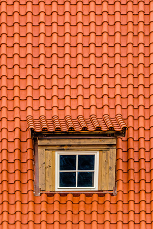 rooftile: Orange Rooftile with Old Attic Rooftop Window Stock Photo
