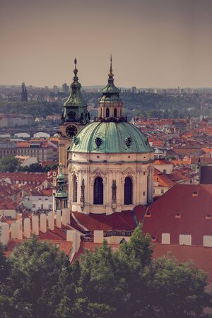 'saint nicholas': Prague Saint Nicholas Church located on Mala Strana PArt of the Old Town, Retro Toned Image Stock Photo