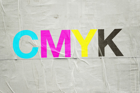 digital printing: CMYK Digital Printing Technology with Cyan, Magenta, Yellow and Black Letters on Glued Poster Paper