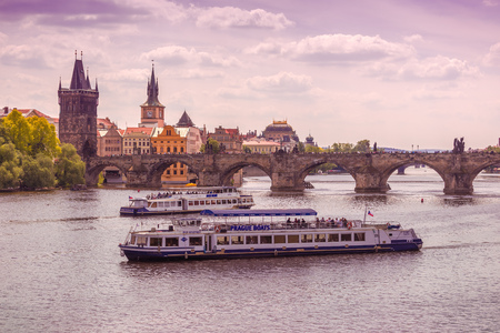 floating bridge: PRAGUE, CZECH REPUBLIC - MAY 22, 2015: Prague Charles Bridge and Tourist Looking at UNESCO Heritage from Boats Floating on River Vltava. Editorial