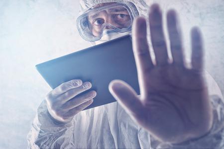 Medical Scientist Reading Internet Pages About MERS Virus on Figital Tablet Computer Standard-Bild