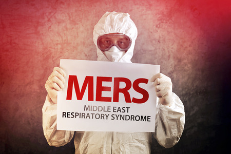 disease control: Medical Scientist Holding Banner with MERS Virus Definition