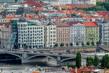 distinctive: PRAGUE, CZECH REPUBLIC - MAY 23, 2015: Dancing House, Also Known As Fred and Ginger, Designed by Vlado Milunic and Frank O. Gehry on the Rasinovo Nabrezi Along with Other Examples of Distinctive Prague Architecture.