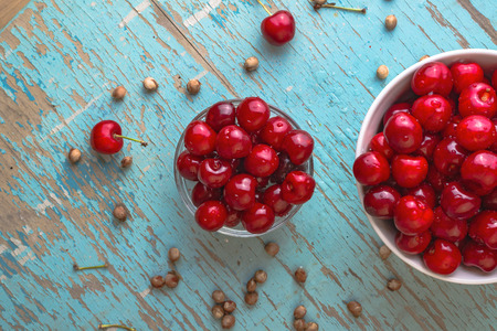 fruit in water: Sweet Cherry in Bowl on Rustic Table, Ripe Fresh Wild Cherries Fruit
