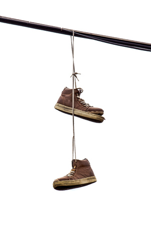 tossing: Shoe Tossing, Old Sneakers Hanging on Powerline Wire, Isolated on White Background