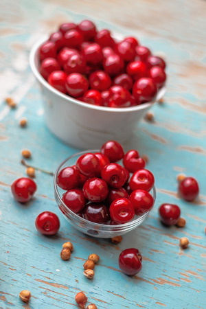 glycemic: Sweet Cherry in Bowl on Rustic Table, Ripe Fresh Wild Cherries Fruit