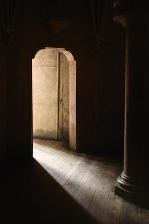 open doorway: Mystic Gothic Door with Sunlight Entering Dark Room, Exit to Light, Hope and New Beginning Concept, Vintage Retro Tone Effect Stock Photo