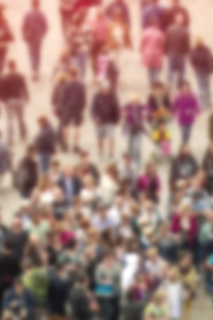 General Public Concept with Unrecognizable Crowded Population Out of Focus, Blurred Crowd of People On City Street, Vintage Toned Image.