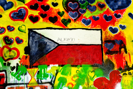 john lennon: PRAGUE, CZECH REPUBLIC - MAY 21, 2015: Czech Republic Flag on Famous John Lennon Wall on Kampa Island in Prague filled with Beatles inspired graffiti and lyrics since the 1980s. Editorial