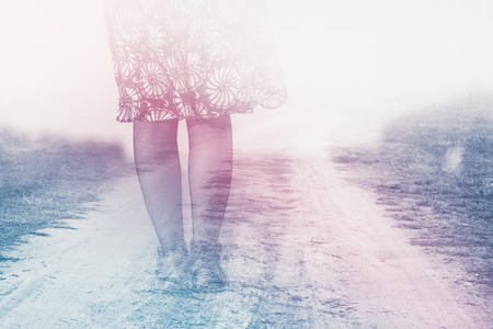 desolation: Female Legs on Country Road to Nowhere, Anxiety Concept, Double Exposure, Vintage Retro Tone Effect Stock Photo