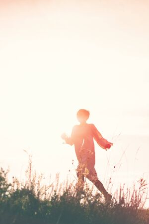 journey: Woman Running to Freedom Through Countryside Field, Silhouette of Female Person, Double Exposure, Vintage Retro Tone Effect.
