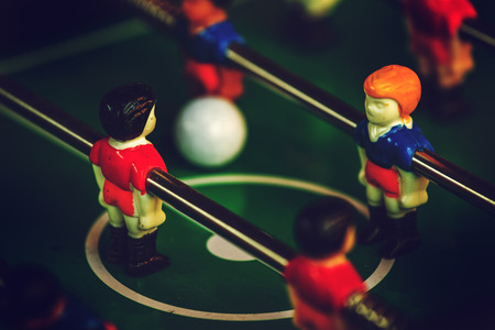 kicker: Table Soccer or Foosball Kicker Game, Selective Focus, Retro Tone Effect