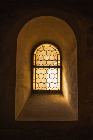 gothic window: Old Window and Light Passing Through Glass, Vintage Retro Tone Effect Stock Photo