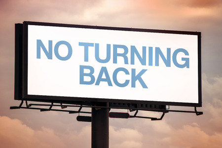 hoarding: No Turning Back Motivational Message on Outdoor Advertsing Billboard Hoarding Against Cloudy Sky