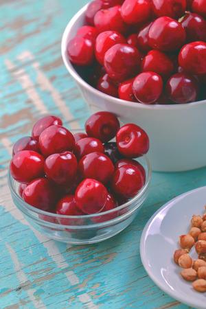 pits: Cherry Bowl on Rustic Table, Ripe Fresh Wild Cherries