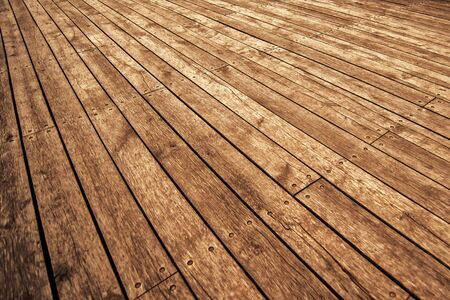 product placement: Rustic Wooden Floor Board Texture in Perspective as Background for Product Placement, Warm Tone Stock Photo