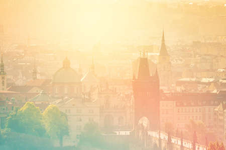 distinctive: Beautiful Panoramic View of Prague Old Town Cityscape with Distinctive Architecture Landmarks on Misty Morning, Vintage Retro Tone effect