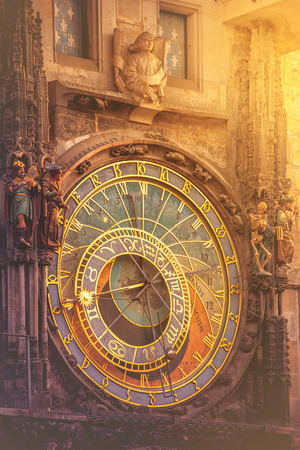 Famous Astronomical Clock on Prague Old Town Square, Tourist Sightseeing Atraction with Vintage Retro Tone Effect and Sinlight Flare, Vertical Image Stock Photo