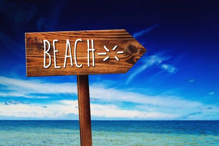 summer sign: To the Beach, Rustic Wooden Direction Sign in Tropical Summer Vacation Resort Stock Photo