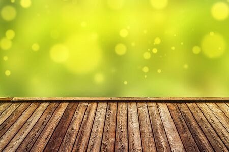 product placement: Empty Rustic Wooden Deck with Abstract Blur Natural Background for Product Placement Backdrop