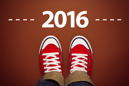 top of the year: Happy New Year 2016 with Person Wearing Red Sneakers from Above, Top View Stock Photo