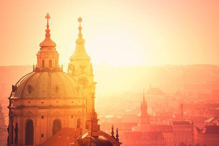 'saint nicholas': Prague Saint Nicholas Church on Misty Spring Morning, Retro Toned Image