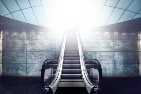 elevator: Escalator Staircase and Exit to Light, Modern Concrete Architecture Interior Stock Photo