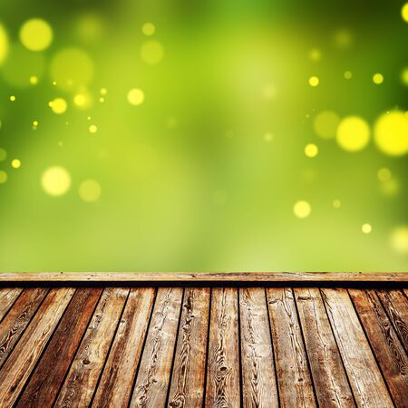 product placement: Empty Rustic Wooden Deck with Abstract Blur Natural Background for Product Placement Backdrop, Square Format Stock Photo