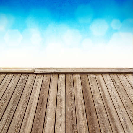 product placement: Empty Rustic Wooden Deck with Abstract Blur Blue Natural Background for Product Placement Backdrop