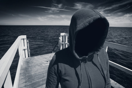 abduction: Abduction Concept, Faceless Hooded Unrecognizable Woman at Ocean Pier, Unknown Spooky Female, Black and White Image