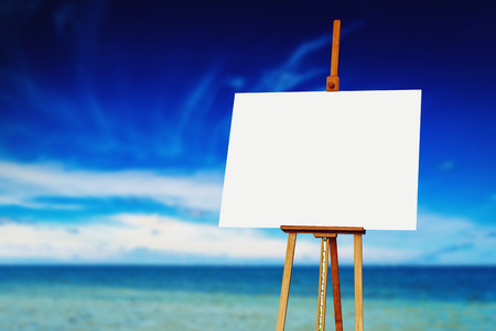 canvas: Easel with Blank Artistic Canvas on the Beach on a Sunny Summer Day