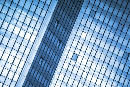abstract building: Modern Business Office Building Windows Repeating Pattern, Blue Glass Facade with Geometric Lines, Sunlight Reflecting