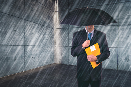tax law: Insurance Agent with Umbrella Protecting from Rain in Urban Outdoor Setting, Risk Assessment and Analysis