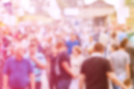 census: Blurred Crowd of People On Street, General Public Concept with Unrecognizable Crowded Population out of Focus, Vintage Toned Image. Stock Photo