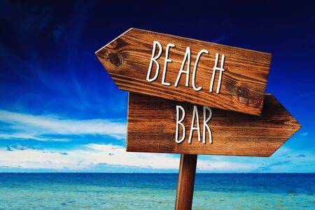 beach bar: To the Beach or to the Bar, Rustic Wooden Direction Sign in Coastal Summer Vacation Resort Stock Photo