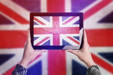 citizenry: Person Taking Picture of United Kingdom of Great Britain Flag with Digital Tablet Computer, Vintage Tone Retro Effect