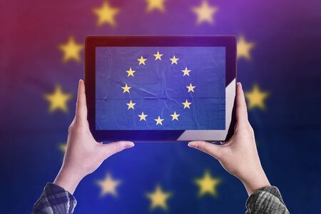 citizenry: Person Taking Picture of European Union Flag with Digital Tablet Computer, Vintage Tone Retro Effect
