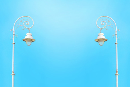 lamp: Two vintage street white lampposts against blue sky