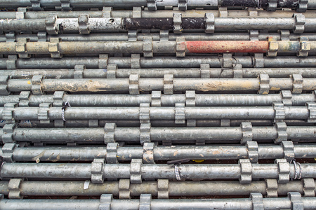 metal pipes: Piled Scaffolding Metal Pipes as Construction Industry Background