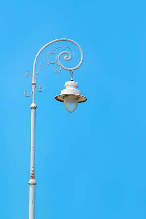 lamppost: Vintage street white lamppost against blue sky Stock Photo