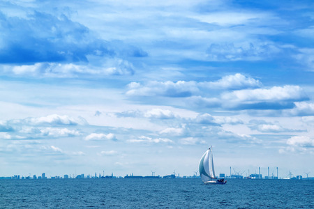 voyage: Boat Sailing on Open Blue Sea, Stormy Clouds at Sky, Uncertain Future Concept