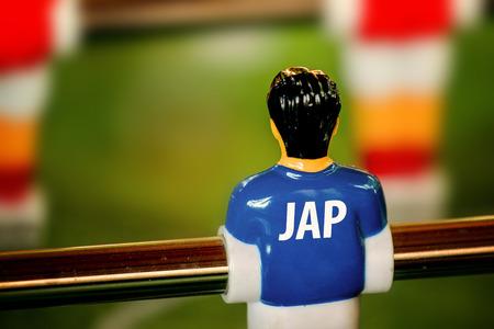 foosball: Japan National Jersey on Vintage Foosball, Table Soccer or Football Kicker Game, Selective Focus, Retro Tone Effect
