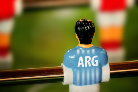 kicker: Argentina National Jersey on Vintage Foosball, Table Soccer or Football Kicker Game, Selective Focus, Retro Tone Effect