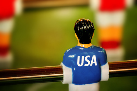 kicker: USA National Jersey on Vintage Foosball, Table Soccer or Football Kicker Game, Selective Focus, Retro Tone Effect
