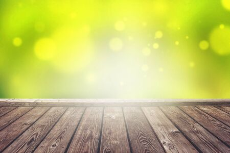 placement: Empty Rustic Wooden Deck with Abstract Blur Natural for Product Placement Backdrop with Sunlight