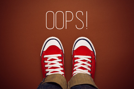 good attitude: Oops, Young Person MAde a Mistake Concept with Red Sneakers from above, Top View