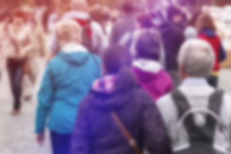 unrecognizable people: Blurred Crowd of People On Street as General Public Concept with Unrecognizable Crowded Group out of Focus, Vintage Toned Image.