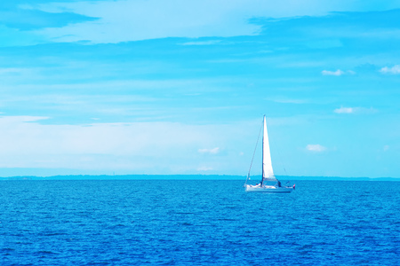 small boat: Boat Sailing on Open Blue Sea on Bright Summer Day Stock Photo